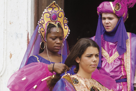 LISBON, ALFAMA, PORTUGAL - june 15, 2005 : during the celebrations of St. Anthony, each district competes for the best festive dress. in this picture, a boy and two girls of the Alfama group
