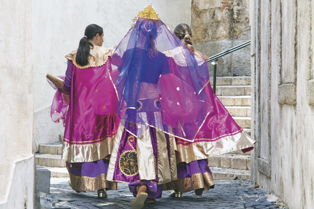LISBON, ALFAMA, PORTUGAL - june 15, 2005 :  During the celebrations of St. Anthony each district forms a group that competes for the best festive dress. the training is difficult and long. Editorial