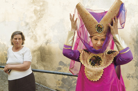 LISBON, ALFAMA, PORTUGAL - june 15, 2005 : during the celebrations of St. Anthony, each district competes for the best festive dress. in this picture, a mother and daughter of the Alfama group Editorial
