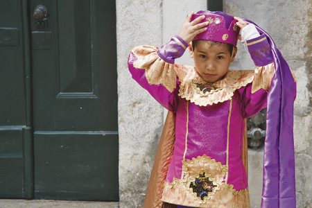 LISBON, ALFAMA, PORTUGAL - june 15, 2005 : during the celebrations of St. Anthony, each district forms a group that competes for the best festive dress. in this picture, a boy from the Alfama group.