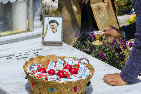 OLYMPOS, KARPATHOS island – april 29, 2008 : procession of Easter Tuesday. offerings for the dead Editorial