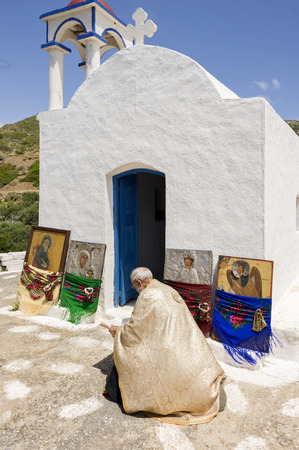 OLYMPOS, KARPATHOS island – april 29, 2008 : procession of Easter Tuesday.The icons are walking in the village and throughout the valley with a stop at each chapel