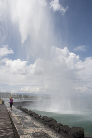 Geneva Switzerland, beautiful sunny day on the pier which leads to the water jet Stock Photo