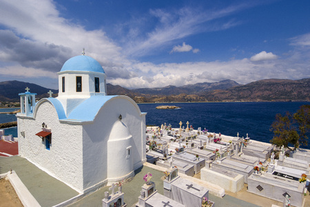 PIGADIA , KARPATHOS GREECE  cemetery on the height of the city of Pigadia Editorial