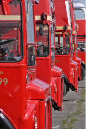 London, UK, April 18, 2010 London red double decker routemaster buses parked in a row  photo