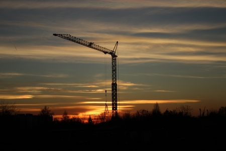 hugh: Silhouette of a crane, in the background a colorful sunset