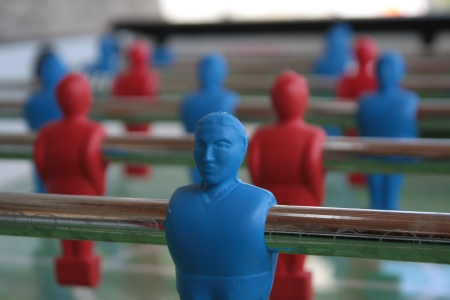 Close up of a blue plastic player of a table football game