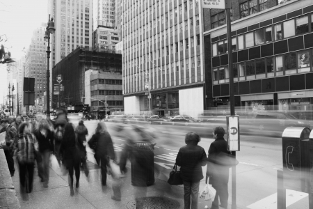 frantic: New York City, NY, USA � March 31, 2010  pedestrians walking on a boardwalk along an avenue in New York City Editorial