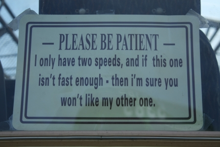 supposed: London, United Kingdom � April 11, 2010  humorous warning mounted on the rear window of a truck, the message is related to the supposed slow speed of the vehicle written on a signboard