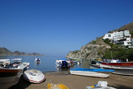 Taganga - July 1, 2019: Landscape - nature scene of a traditional boat on the beach of Taganga, Santa Marta (Colombia) 版權商用圖片 - 134879499