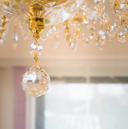 Crystal glass glittering chandelier in room