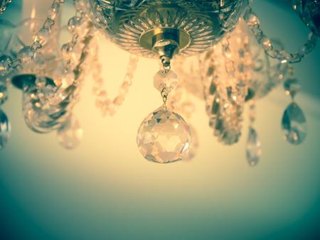 Quiet room chandelier,cross processed colors. Stock Photo