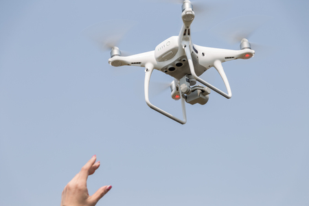 maneuvering: Womens hand catching drone Stock Photo