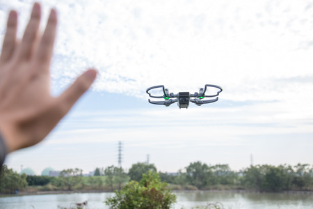 High performance small drone operated by hand Stock Photo