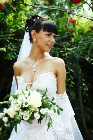 guelder: Beautiful bride woman with guelder rose on the background outdoors