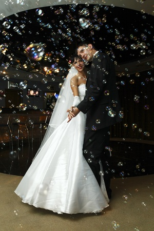 bride and groom dancing in the restaurant photo