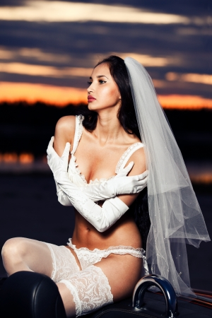 Bride in lingerie on the cabriolet photo