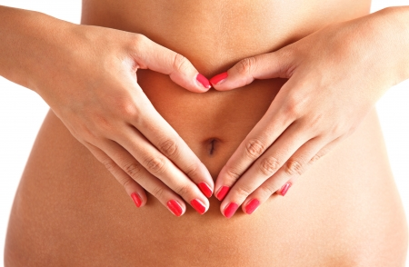tummy: Belly with hands on it. Heart Stock Photo
