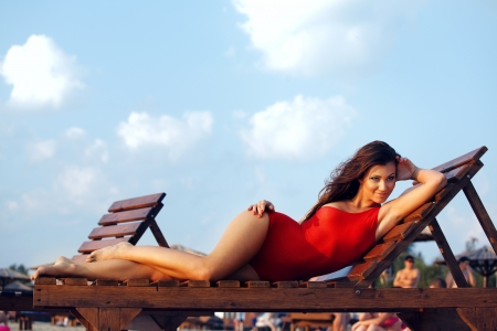 Hot brunette in red swimsuit photo