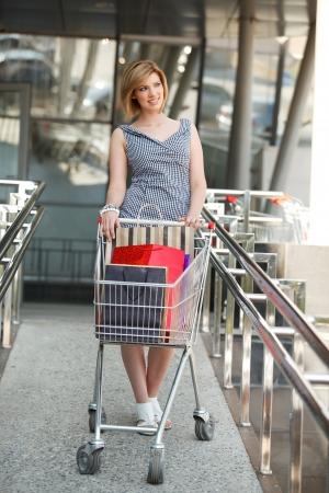 beautifull woman: Beautifull woman with shopping cart Stock Photo
