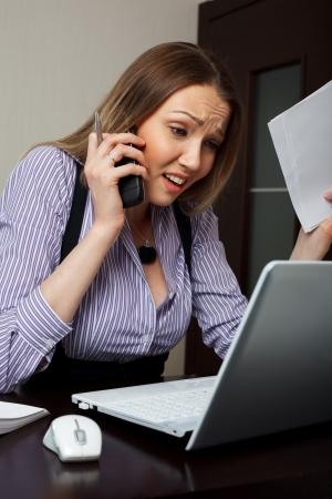 secretaries: Stress business woman On the phone