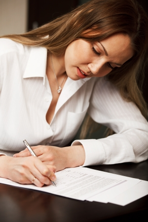 Woman signing contract photo