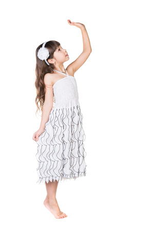 Funny little girl. Good for borders of articles or websites. Beautiful caucasian model. Isolated on white background. photo