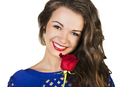 Beautiful young woman holding red rose photo