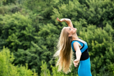 arms  outstretched: Young woman standing with her arms outstretched