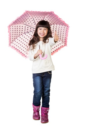Beautiful little girl with umbrella. Isolated on white background photo