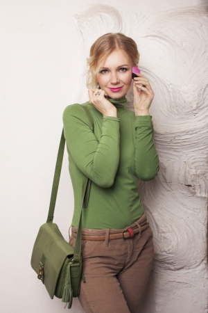 Beauty Girl with Makeup Brushes. Natural Make-up for Blonde Woman. photo