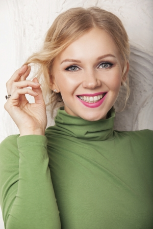 Portrait of attractive caucasian smiling woman blond. studio shot photo
