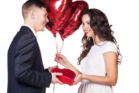 Gift. Surprise. Guy holding present and balloons photo