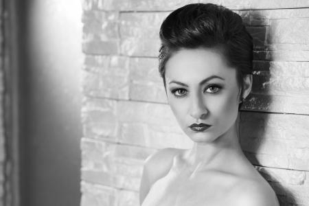Beautiful woman with elegant hairstyle. Fashion photo photo