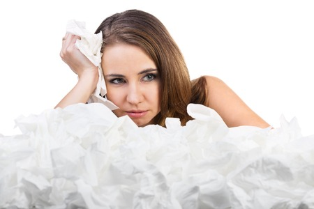 Ill woman with a lot of hankys. Isolated on white background Stock Photo - 25351541