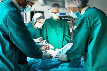 medical equipment: Surgery team operating in a surgical room