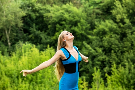 Young woman standing with her arms outstretched photo