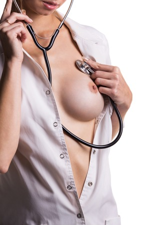 Topless fit woman torso with stethoscope, isolated on white background