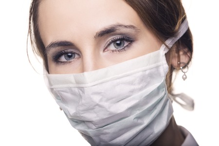 Close up of a doctor in surgical mask photo