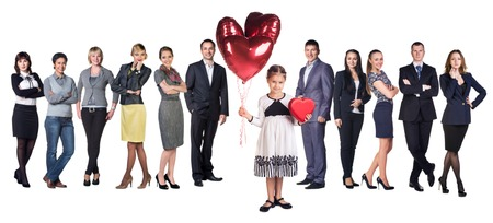 Little girl smile present gift red heart shaped box and balloons in hands. Little girl over big group of Business people on background photo