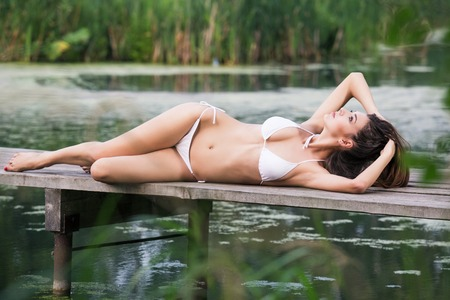 Beautiful sexy lady having sunbath photo