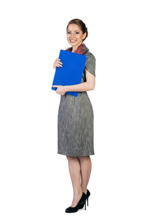 Beautiful young business woman with folder photo