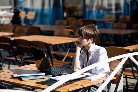 Beautiful lady in cafe with laptop photo