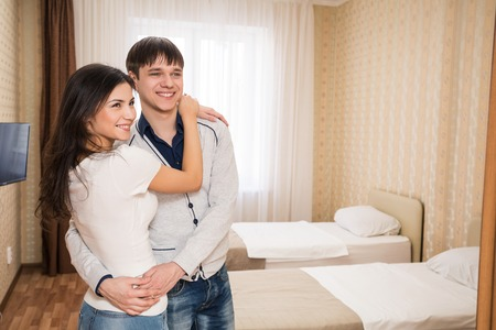 Young happy couple invite to bedroom photo
