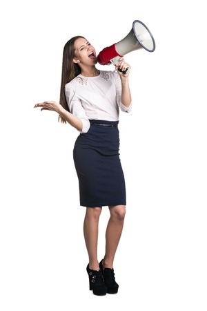 Business woman with megaphone yelling and screaming isolated on white  Stock Photo