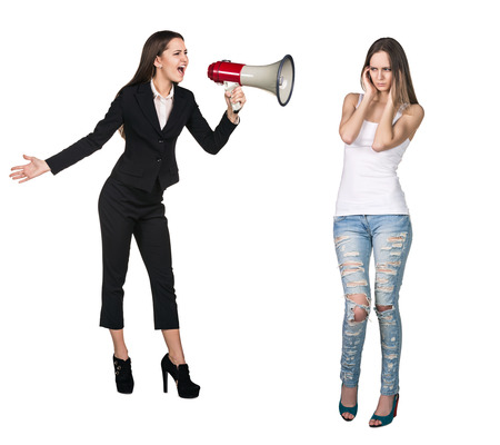 berate: Quarrel. Boss woman crying in megaphone to her employee Stock Photo