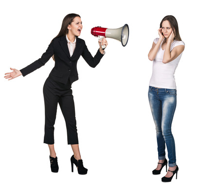 wail: Quarrel. Boss woman crying in megaphone to her employee Stock Photo