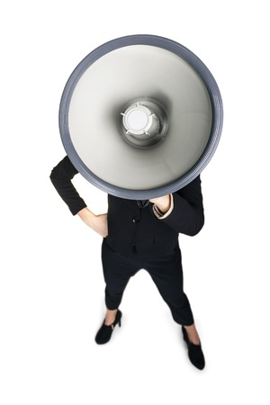 Business woman with megaphone yelling and screaming isolated on white background Stock Photo