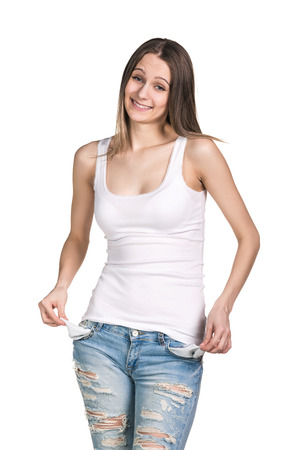 young woman showing empty pockets. isolated on white background