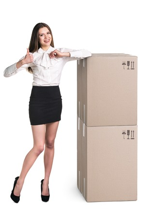Beautiful Woman with boxes on white photo